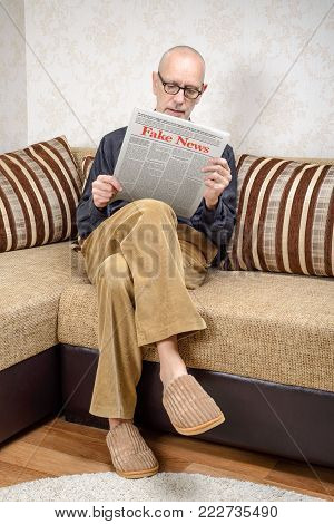 Man Reading Fake News On A Daily Paper
