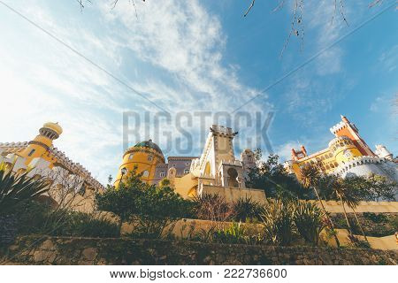 View from tourist perspective of popular Portuguese historical landmark National Palace of Pena,royal caste of Portugal.Colorful Romanticist architectural wonder.UNESCO World Heritage Site in Sintra.