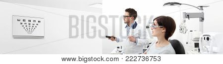 woman in the optometrist office examining her eyesight, he is pointing at the chart monitor remote controller, eye care concept, web banner template
