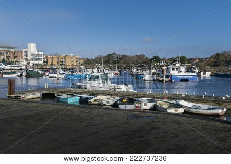 LYMINGTON, NEW FOREST, HAMPSHIRE, UK, JANUARY 2018 - View of the harbour and boats at Lymington, New Forest, Hampshire, UK