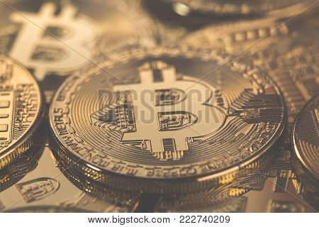 Bitcoins  on the microchip background with tone effect. Physical bit coins. Digital currency. Cryptocurrency. Golden coins with bitcoin.