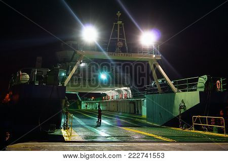 Labuan,Malaysia-Dec 26,2015:Night view of ferry ship transporting people & cars from Labuan island to Menumbok,Sabah,Malaysia.There is a daily ferry service between Menumbok,Sabah and Labuan island,Malaysia