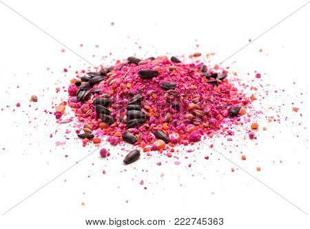 Pile of rat poison on white background -Wheat, corn and sunflower mixed with poison