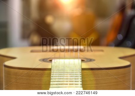 Guitar of a guitar close-up in horizontal position, soft focus.