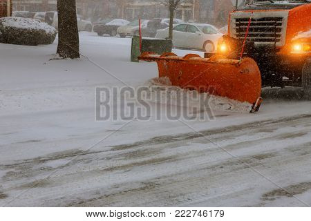 Snow tractor removes snow during snowfall Tractor Snow clearing