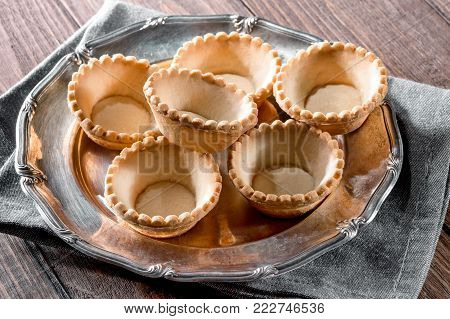 Tartlets On Silver Vintage Plate Decorated With Linen Napkin On Wooden Table Background