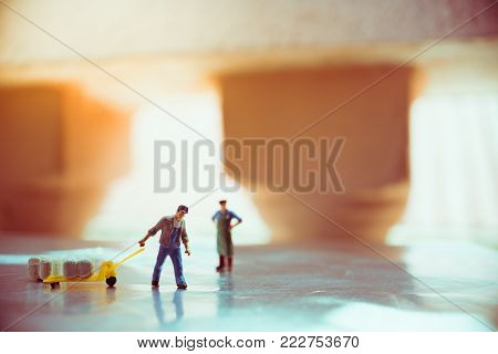 Miniature people, worker and employer at work site, using for logistic and business concept