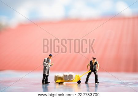 Miniature people, employer control their labor at work site, using for logistic and business concept