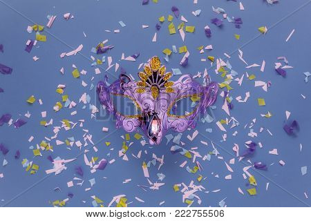 Table top view aerial image of beautiful silver carnival mask for carnaval holiday background concept.Object on modern rustic pink paper at home office desk studio.space for creative design text.