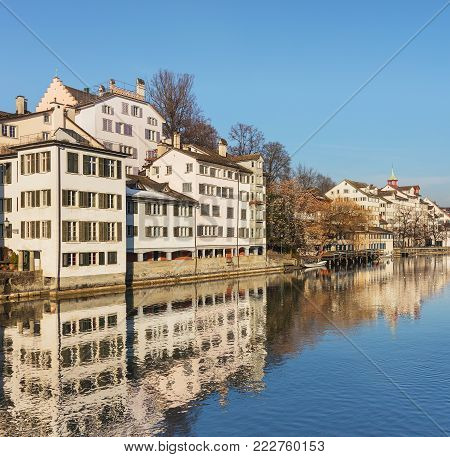The Limmat river and buildings of the historic center of the Swiss city of Zurich in wintertime.