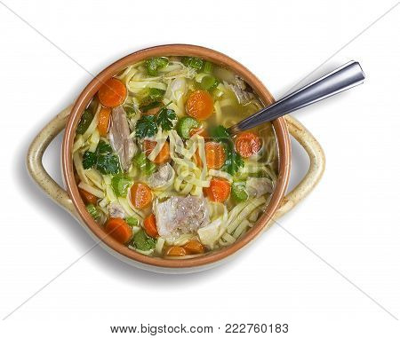Chicken soup with noodles and vegetables on white background. High-angle shot.