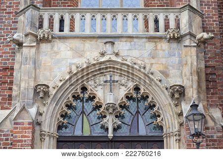 13th century Gothic Collegiate Church of the Holy Cross and St. Bartholomew, Ostrow Tumski, Wroclaw, Poland.  It is a two-storey brick church on the Cathedral Island