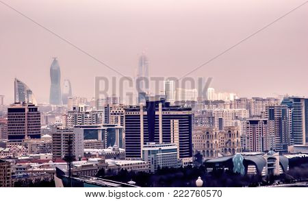 The big city in the fog is a top view. Baku city.