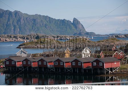 Norwegian landscape with red fishing houses on stilts