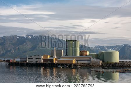 industrial landscape with fishing factory complex on mauntain and sea nature background