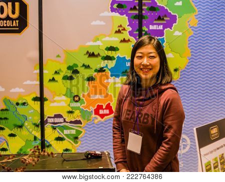 Seoul, South Korea, January, 19, 2018: Asian woman posing in front of colorful map at the Seoul Salon of Chocolate exhibition at COEX Mall