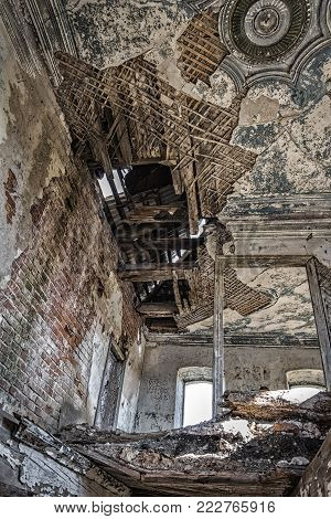 Inside an old dilapidated abandoned brick house.