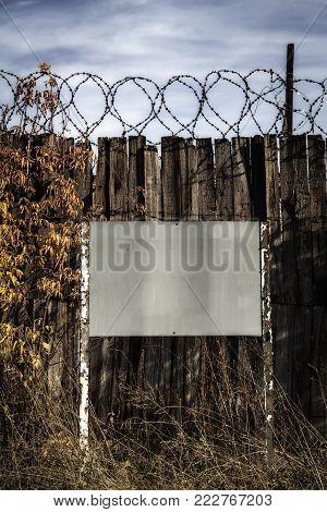 A Sign Near The Fence