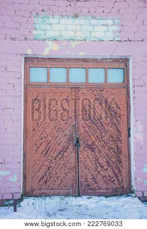 door of an old abandoned barn, building