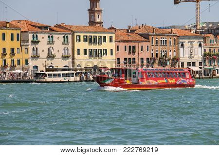 Venice, Italy - August 13, 2016: Passengers boats with tourists in the Adriatic Sea