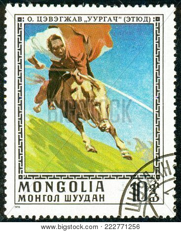 Ukraine - circa 2018: A postage stamp printed in Mongolia show Taming wild horse. Series: Paintings by O. Cevegshava. Circa 1976.