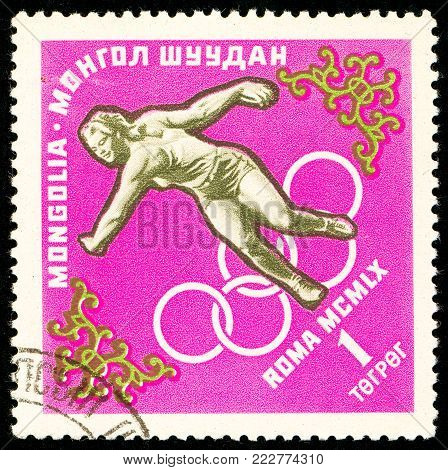Ukraine - circa 2018: A postage stamp printed in Mongolia show Discus throw. Series: Summer Olympics 1960, Rome. Circa 1960.