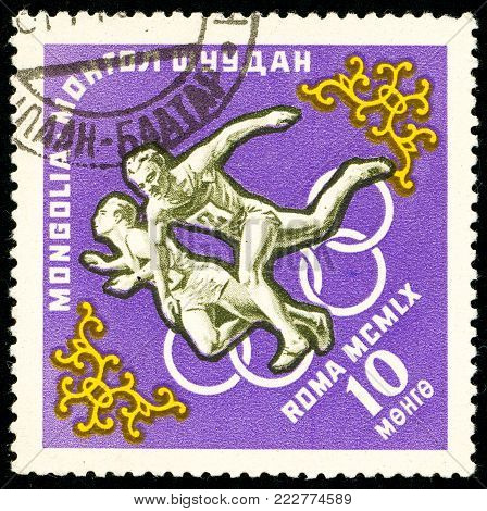 Ukraine - circa 2018: A postage stamp printed in Mongolia show Running. Series: Summer Olympics 1960, Rome. Circa 1960.