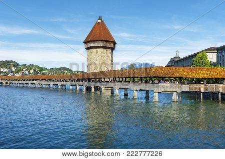 Lucerne, Switzerland - May 2017: View On The Chapel Bridge - Old Wooden Structure Over Reuss River D