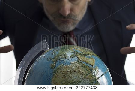Narcissism, Greed and Power concept with earth globe over white background
