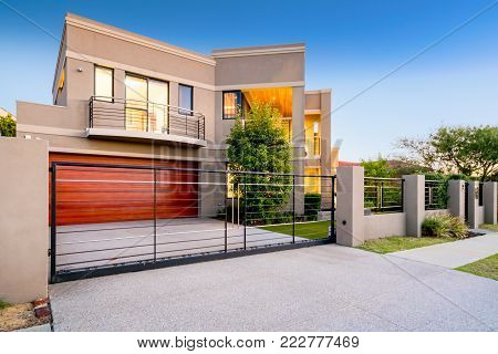 Front elevation of a large double story modern Australian style home.