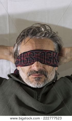 mature man blindfold, blindness human rights concept