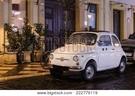 Budapest, HUNGARY - Jan 19 2018: Fiat 500 vintage old car parked on street. Fiat 500 was one of the most produced European cars manufactured in years 1957-1975.