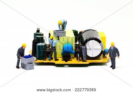 Workers repair computer detail. Miniature worker figurine and micro chip. Men at work macro photo. Computer repair banner template. Fixing electronic hardware. Computer industry. Colorful work site