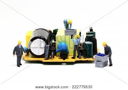 Workers repair computer charger. Miniature worker figurine and micro chip. Men at work macro photo. Computer repair banner template. Fixing electronic hardware. Computer industry concept. Repair site