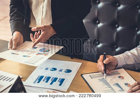 Business team meeting working with new startup project, discussion and analysis data graph report, business market growth on workplace, professional occupation, Partner meetings and collaboration.