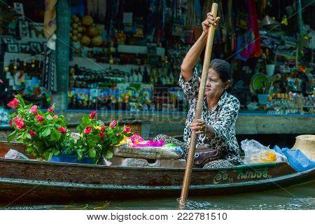 Bangkok,Thailand - May 15th 2017: Vendor at Damnoen Saduak Floating Market, Thailand