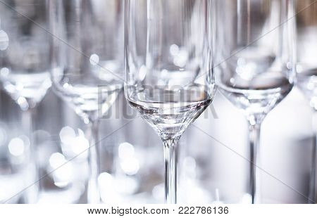 Elegant Luxury Shiny Wine Glasses Lined Up In Rows On Bar Table Background Image