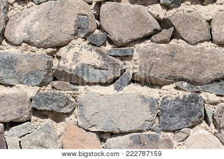 natural heavy rocks and bricks Stones and bricks used for construction and natural sand embedded between layers of rocks