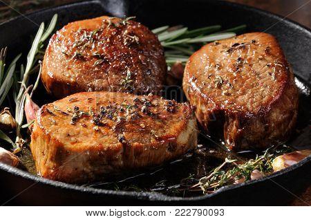 Beef steak. Juicy medium Rib Eye steak slices  herbs spices