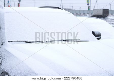 A car in the snow. Frozen windshield