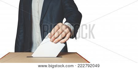 Man Voter Putting Ballot Into Voting box. Democracy Freedom Concept Isolated With Copy-Space poster