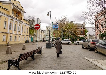 Moscow, Russia - Oct 16, 2016. A woman walking on street in Moscow, Russia. Moscow is the capital and most populous city of Russia, with 12.2 million residents.