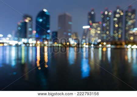 Night blurred bokeh light Singapore city office building seafront, abstract background
