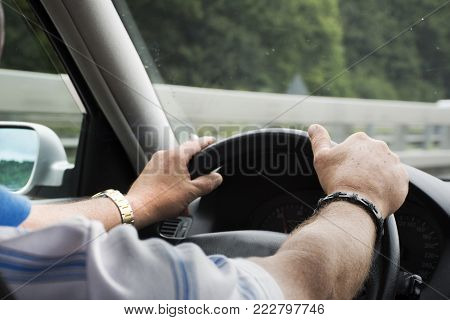 German Old Man Driving Car Very Fast And Smoking Cigarette On Highway Of Stuttgart Go To Austria And