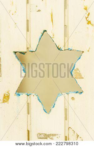 Religion jewish symbol star of David on fence. Traditional judaism icon.