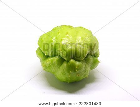 Chayote vegetable isolated on white. Exotic vegetable chayote studio photo. Green vegetable ingredient of mexican cuisine. Traditional Philippines food. Whole ripe chayote vegetable. Vegetarian food