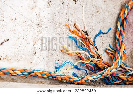 Tip of a cutted rope inside a boat
