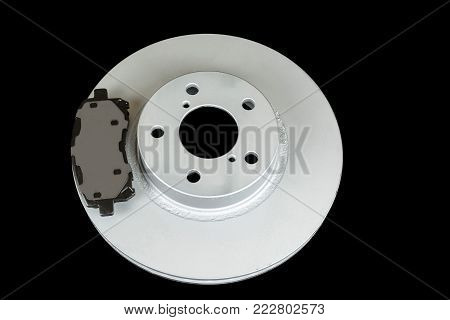 Brake disc and pads on a black background