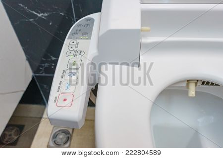 Control Panel of the toilet bowl. Hygienic and high technology of the toilet bowl, automatic modern flush toilet.