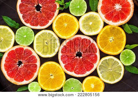 Citrus Food Pattern On White Background - Assorted Citrus Fruits With Mint Leaves On Black Backgroun